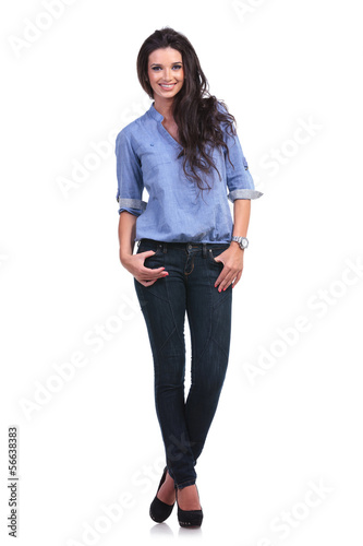 casual woman with both thumbs in pockets