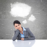 business woman at her desk with clouds as speech bubble