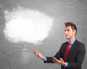 business man holding a cloud on his hands