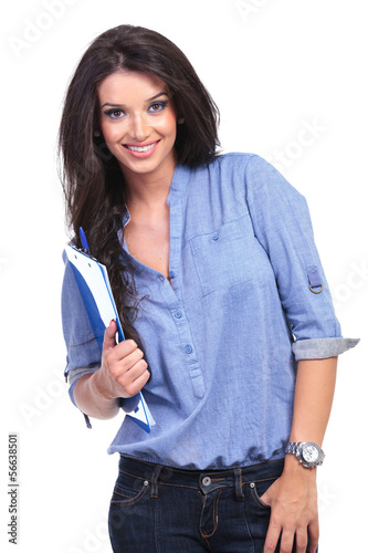 casual woman with clipboard and thumb in pocket