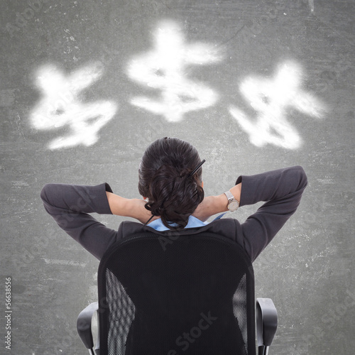 business woman looking at cloudy dollar symbols