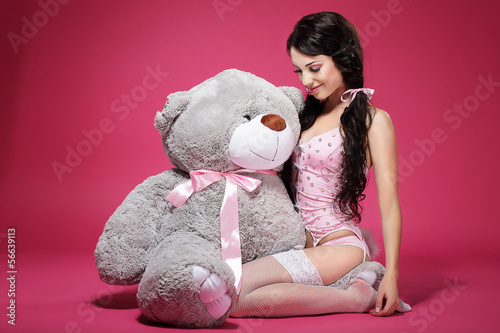 Birthday. Woman with Teddy Bear Sitting and Smiling. Dearness