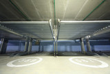 Electrolifts inside indoor two-level parking with numbers