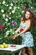 Beautiful woman puts bunch of flowers on table