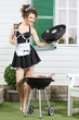 Beautiful housemaid keeps lid and metal blade near country house