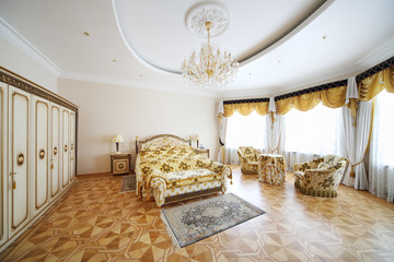 Bedroom with beautiful double bed, wardrobe and armchairs