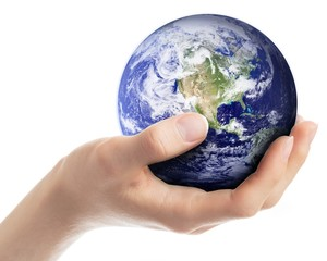 Earth in hand - elements of this image furnished by NASA.