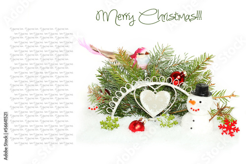 Christmas decoration: fir sprig, ball and bird