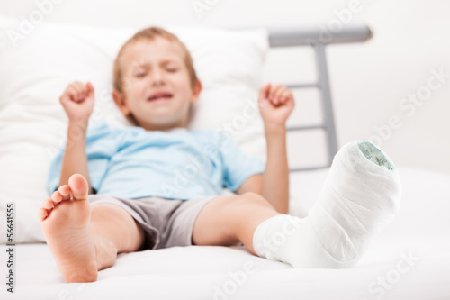 Little child boy with plaster bandage on leg heel fracture or br
