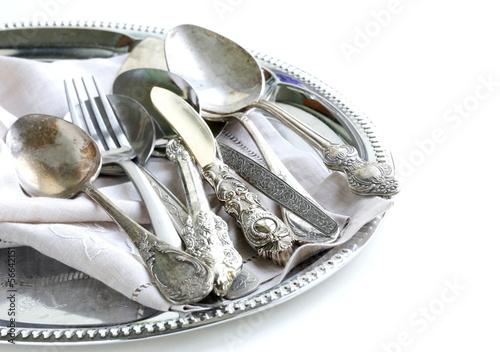Leinwandbild Motiv vintage cutlery with old-fashioned napkin on a silver tray
