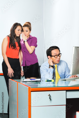 Asian Women bullying colleague in office