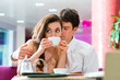 Young couple cafe drinking coffee