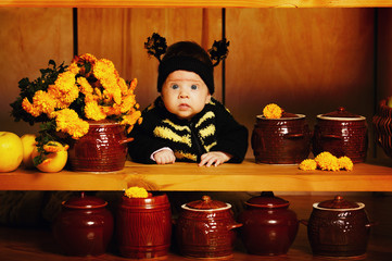 little funny baby with bee costume