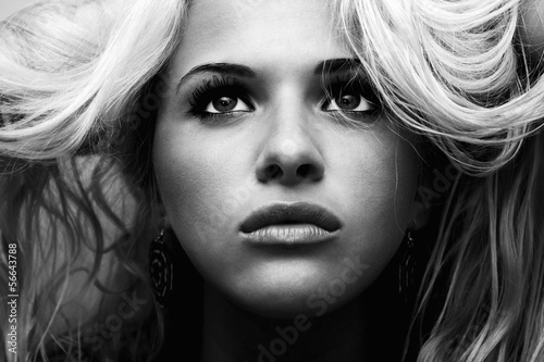 Beautiful blond woman.volume hair.high contrast