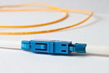 Macro Fiber optic patchcord on white background