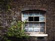 Broken window in an abandoned house