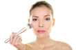 Makeup beauty Asian woman applying blush on face