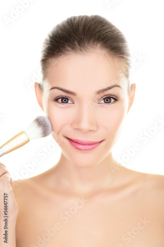 Asian beauty woman putting makeup blush on face