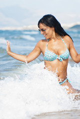 Beautiful girl in wave surf