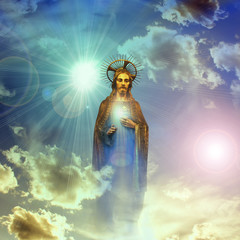 jesus christ gold statue with blue sky clouds background