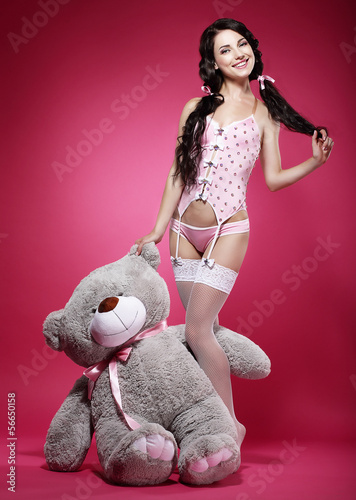 Birthday. Playful Enticing Woman holding her Gift - Teddy Bear
