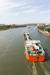 Multi-colored ships pass under the drawbridge