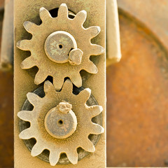 Old metal cog gears meshing together