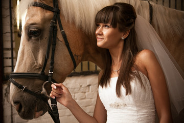 Bride holding horse by rein