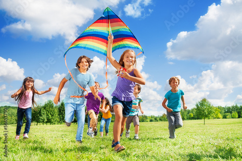 Many active kids with kite - 56653750