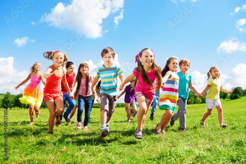 Kids running enjoying summer - 56653760
