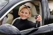 Proud woman driver holding up her car keys