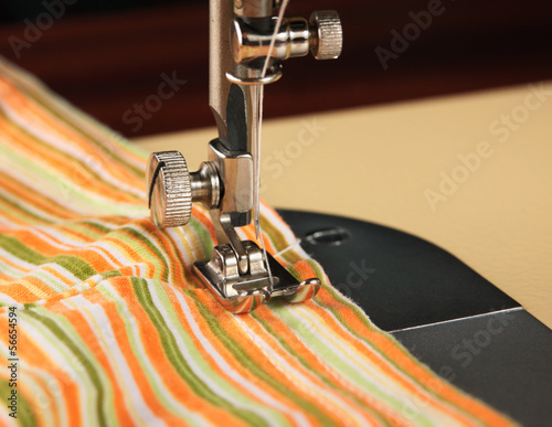 Sewing machine working part with striped cloth