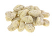 A small pile of potato gnocchi on a white background