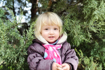 toddler hidden in bushes