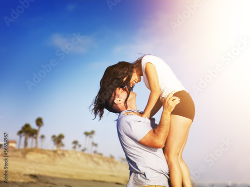 romantic couple in intimate moment on the beach.