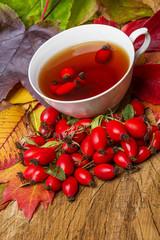 rosehip tea and autumn leaves
