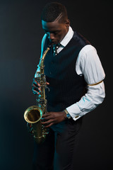 Retro african american jazz musician playing on his saxophone. W
