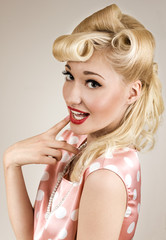 Pin-up style portrait of smiling shy woman