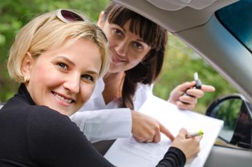 Proud successful woman purchasing a car