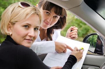 Saleslady assisting a customer to buy a car