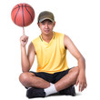 Teenager boy sitting with basketball