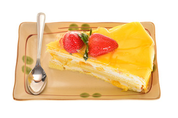 A Slice Of Mango Favored Cake With Strawberry Dressing