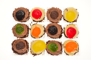 Colorful Mini Cup Cakes With Fruit Cream Topping