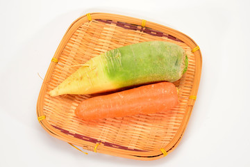 Radish And Carrot On Straw Tray