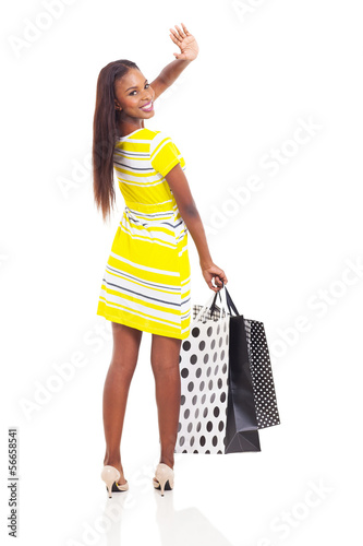 african shopper waving goodbye