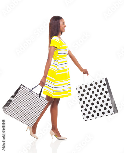 afro american woman walking with shopping bags