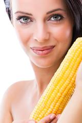 woman holding a peeled corn cob