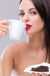 Beautiful woman drinking hot coffee