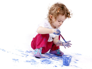 Little baby artist with watercolors
