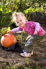 Little girl with a pumpkin